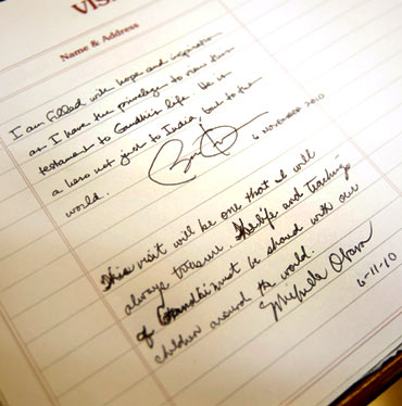 Handwritten notes by US President Barack Obama and first lady Michelle Obama are seen at the Mani Bhavan Gandhi Museum