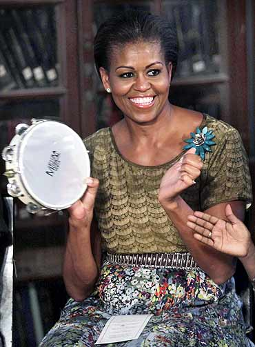 US First Lady Michelle Obama has a ball of a time as she interacts with differently-abled children at a library in the Mumbai university's south Mumbai campus