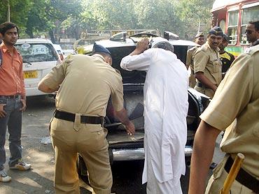 Cops check a taxi