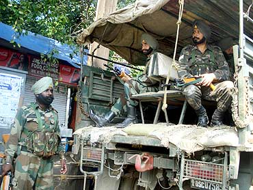 Paramilitary forces keep vigil