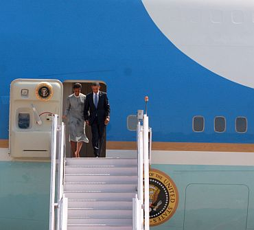 President Obama exits Air Force One with wife Michelle