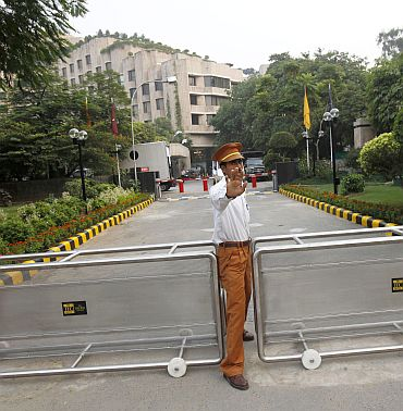A hotel security guard stops the media outside the Hotel Maurya Sheraton in New Delhi