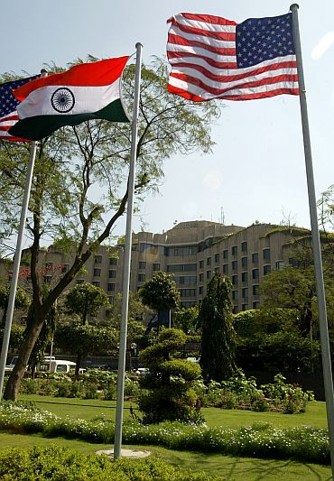Indian and US flags fly outside the Maurya hotel