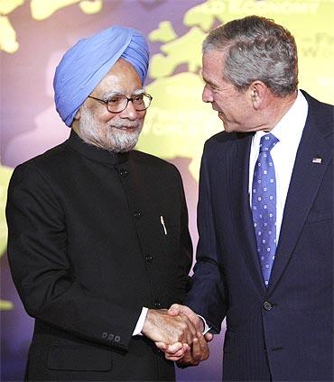 US President George W Bush greets Prime Minister Manmohan Singh