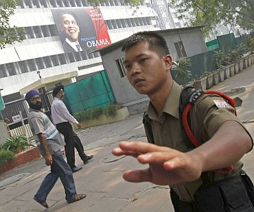 Security personnel stop the media outside the American Centre in New Delhi