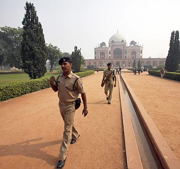 Security personnel keep watch inside the lawns of Humayun's Tomb
