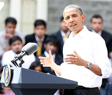 US President Barack Obama interacts with students at St Xavier's College in Mumbai