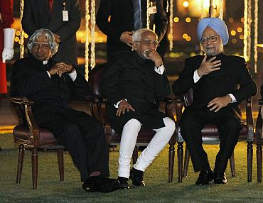 Former President APJ Abdul Kalam, Vice President Hamid Ansari and Prime Minister Manmohan Singh at the dinner