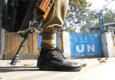 A  policeman guards the main gate of the United Nations Military Observer Group in Srinagar