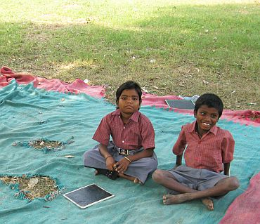 The kids in their school, a bedsheet spread under a tree in a sprawling Mughal garden in Old Fort complex