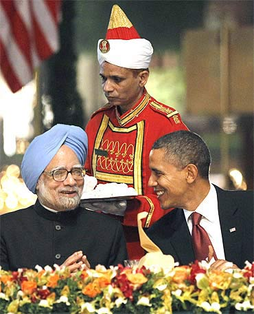 US President Barack Obama speaks with Prime Minister Manmohan Singh during their state dinner at Rashtrapati Bhavan on Monday