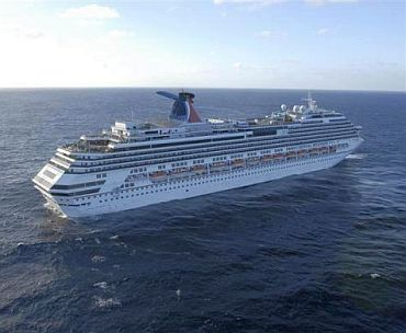 The Carnival cruise ship Splendor sits adrift in the Pacific Ocean approximately 150 nautical miles southwest of San Diego