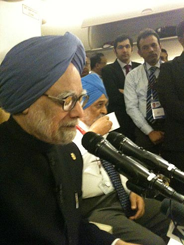 Prime Minister Manmohan Singh speaks to media-persons on board Air India One