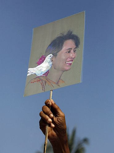 A member of the National League for Democracy holds a sketch of Aung San Suu Kyi during a protest demanding her release from house arrest in Yangon