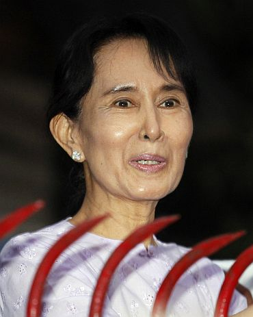 Aung San Suu Kyi speaks with supporters after she was released from house arrest in Yangon