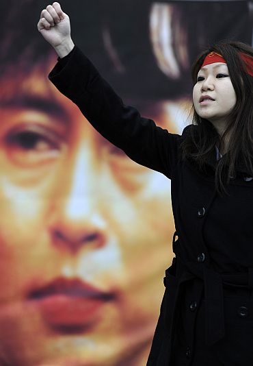 A supporter of Aung San Suu Kyi demonstrates in Trafalgar Square London on Saturday
