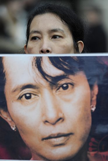 A supporter of Aung San Suu Kyi demonstrates in Trafalgar Square London