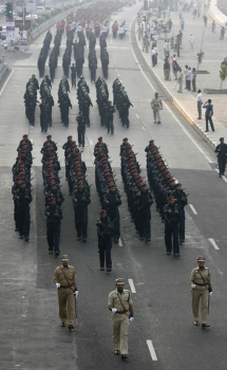 Platoons of Mumbai police conduct a march past near the seafront in Mumbai in memory of the 166 people killed in the 26/11 terror attack