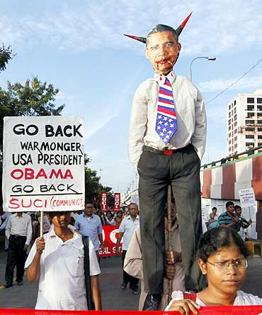 Activists with an effigy depicting President Obama during a protest in Kolkata