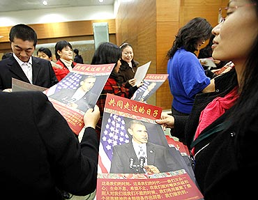 Participants with posters of President Obama after a townhall-style meeting in Shanghai, China