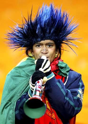 A fan blows a Vuvuzela