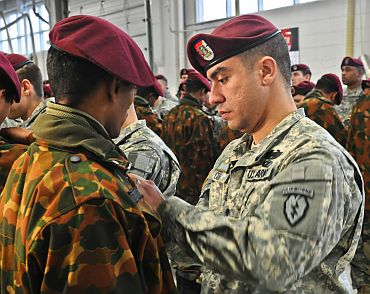 A US soldier pins US Army airborne jump wings on an Indian army soldier during a wing exchange ceremony on November 13 at Joint Base Elmendorf-Richardson, Alaska. The Soldiers earned their foreign jump wings on November 10 when they conducted a combined jump