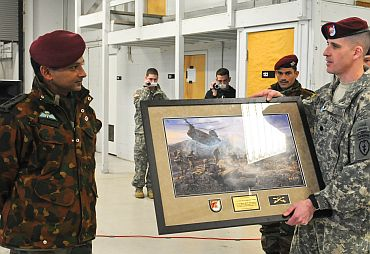 Lt Col Christopher J Cassibry, commander of 1st Squadron (Airborne), 40th Cavalry Regiment, 4th Brigade Combat Team (Airborne), 25th Infantry Division, presents a gift to a leader from the Indian army during an airborne jump wing exchange ceremony on November 13