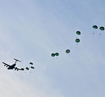 Soldiers from US Army Alaska and the Indian Army jump from a C-17 during the combined airborne jump that landed them at Malamute drop-zone Joint Base Elmendorf-Richardson