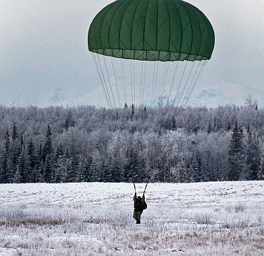 An Indian soldier prepares to land at Malamute drop-zone