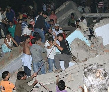 Local residents search for survivors under the rubble