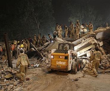 escue workers search for survivors under the rubble