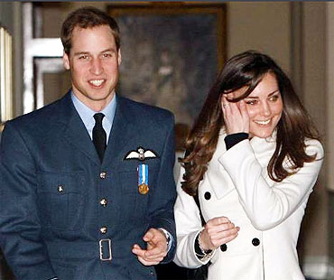File picture of Britain's Prince William (L) is seen smiling as he walks with his girlfriend Kate Middleton at RAF Cranwell
