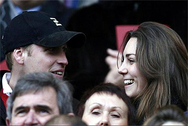 Prince Williams and his girlfriend Kate Middleton react during a rugby match in London