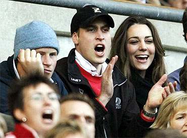 Prince Williams and Middleton cheer during a rugby match