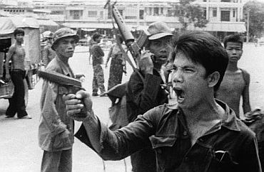 Soldiers of the Khmer Rouge regime threatening local Vietnamese