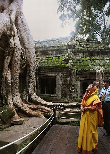 President Pratibha Patil takes a look at one of the structures at the Ta Prohm Temple near Angkor Wat, which has been overgrown by trees. The President made the visit on September 17