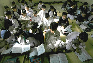 Students inside the classroom of a school in Jamaat-ud-Dawa's headquarters
