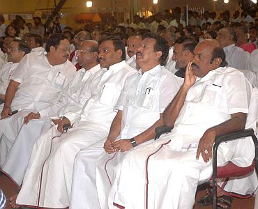 Former Telecom minister A Raja is seen sitting with fellow DMK leaders
