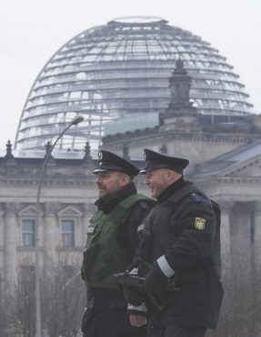 Policemen patrol near the Bundestag