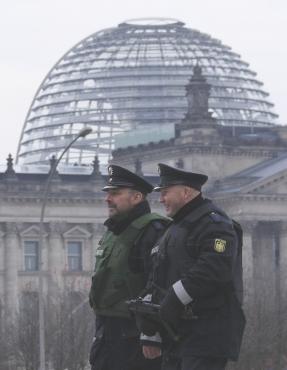 Policemen patrol near the Bundestag