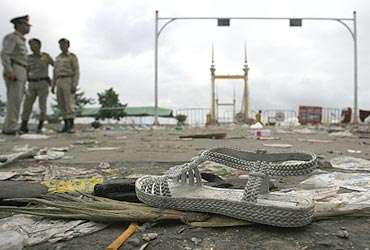 A woman's shoe is seen among the debris as police cordon off the bridge