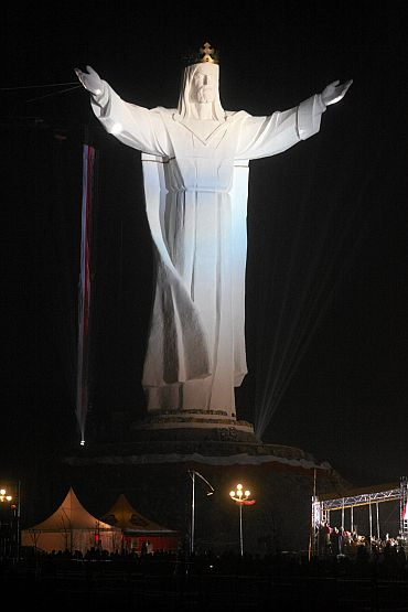 People take part in the celebrations of the unveiling of the statue of Jesus in Swiebodzin