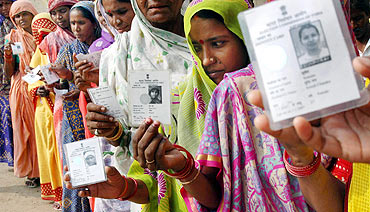 People line up to cast their votes during the Bihar polls
