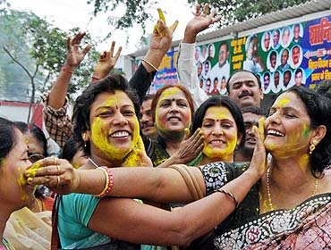 Janata Dal-United supporters celebrate their party's victory in Patna