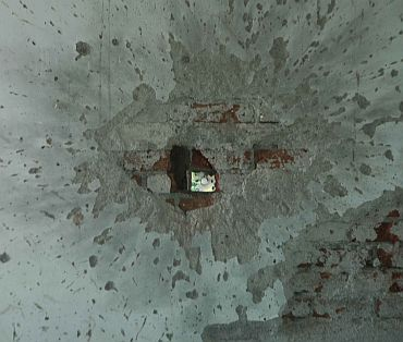 Bullet marks from the attack still remain