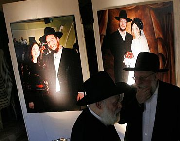 Images of the slain Rabbi and his wife at Chabad House
