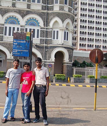 From left: Rajesh Tubati, Madan Kumar and Jaya Kumar outside Hotel Taj