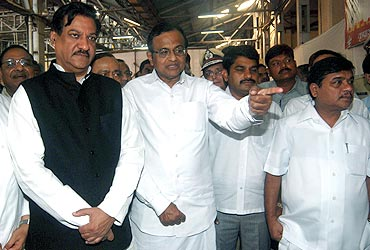 Home Minister P Chidambaram with Maharashtra Chief Minister Prithviraj Chavan at martyrs memorial in South Mumbai on Friday