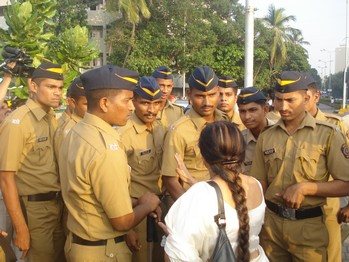 Anuradha Gore (back to the camera) argues with a bunch of policemen at Marine Drive in Mumbai