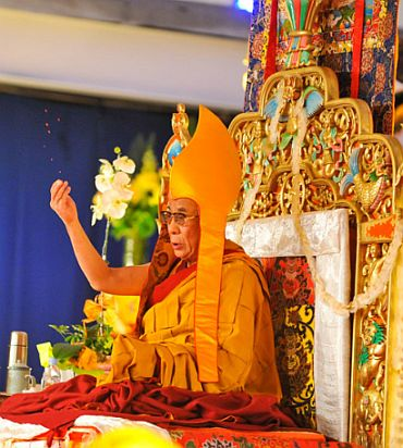 The Dalai Lama performs a prayer in Dharamsala, where he lives